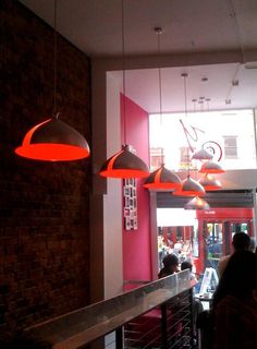 Grito lampshades in a London Cafe. Grito was designed by El Ultimo Grito.  http://www.mathmos.com/mathmos-grito-lamp-shade-880-0.html
