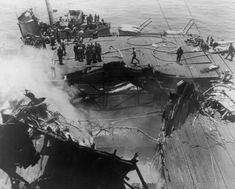 Gaping hole in the deck of aircraft carrier USS Bunker Hill (CV-17) which was badly damaged & set ablaze after being hit twice in thirty seconds by Japanese kamikaze pilots off the coast of Japan.