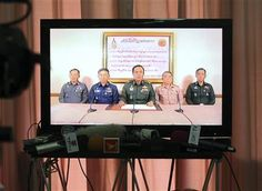 Thai Army Chief Gen. Prayuth Chan-Ocha, center, and other high ranking Thai officers are shown on television announcing the military takeover in Bangkok, Thailand Thursday, May 22, 2014. (AP Photo/Apichart Weerawong) ▼22May2014AP|Thai military seizes power in coup, imposes curfew http://bigstory.ap.org/article/thailands-political-rivals-meet-more-talks #Prayut_Chan_O_Cha #Bangkok #Coup_detat