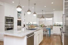 Amazing Glossy Lamps in the Contemporary Kitchen with White Island and Grey Quartz Countertops White Cabinets