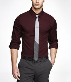 Maroon dress shirt, gray slacks, and black belt with two-toned white and gray tie.