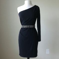 One shoulder knit jersey black dress Jeweled belt is not for sale!!!!!!! Gold tone metal bar on one shoulder, matte jersey, pullover style, contoured stretch fit, lined, 96% polyester,  4% spandex,  bust 34 inches,  waist 29 inches, hip 38.5 inches, length 36 inches White House Black Market Dresses Midi