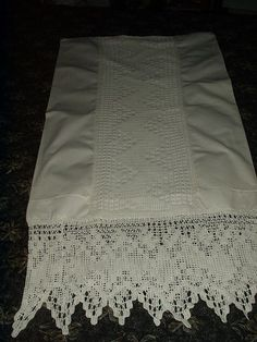 Early 1900's pillowcase with insertion and edge trim of filet crochet.