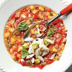 Summer Gazpacho with Avocado West Indies Salad | Serve this immediately on busy weeknights for a fresh and light meal. Or make ahead and chill to let the flavors brighten even more. | #Recipes | SouthernLiving.com