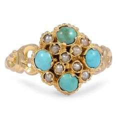 This remarkable yellow gold ring from the Victorian era showcases a cluster of seed pearl accents, flanked on four sides by four round turquoise cabochon accents.