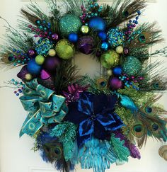 miobello: Peacock wreath is beautiful. Great for Mardi GrasChristmas Peacock Wreath XXL by ViennaSparkleWreaths on .miobello: Peacock wreath is beautiful. does it harm the Peacock, or do we normally get the feathers through a shedding process? Peacock Wreath, Peacock Decor, Peacock Colors, Purple Peacock, Peacock Theme, Peacock Feathers, Pink Purple, Blue Green, Holiday Wreaths