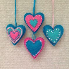 Felt heart ornaments in turquoise, pink and white. Set of 4 by Lucismiles on Etsy