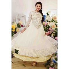 Gauhar Khan (also known as Gauahar Khan) is an Indian model and actress. gauhar khan in anarkali suit, Photos, Biography, Videos and Wallpapers. Gauhar Khan profile on SKBMART.com Look sensationally awesome in this White Georgette Anarkali Suit as Gauhar Khan. Anarkali fully decorated with cream resham embroidery, floral patch, stones and zari work on all over yoke and back. Sleeves of the suit also decorated with the same floral embroidry work.