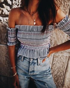 Pretty off the shoulder ruffled top with blue jeans.