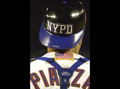New York Mets catcher Mike Piazza wears the NYPD logo on his helmet. 9/21/2001