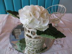 Vintage birdcage arrangement of hydrangea by Apple Blossom Flowers & Wedding Hire