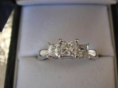 18k white gold ring, size 7.5  3-stones, 1 ctw  1/2 Carat center diamond, Clarity: SI1 Color: H  Very Good cut, Very Good polish, and Very Good symmetry  Value: $3200