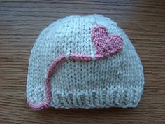 Ravelry  Heart on a String pattern by Susan B. Anderson Baby Hats Knitting 3944ab1bcc35
