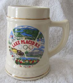 cool Classic Uncommon Lake Placid NY Olympics 5 1/four Inch Ceramic Gold Trim Beer Mug Stein