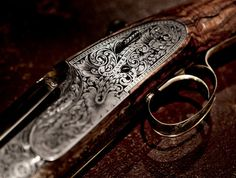 Beautiful engraving on a Holland and Holland shotgun.