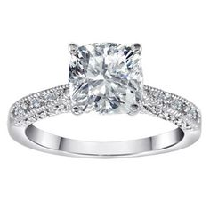 Pretty engagement ring. I love the solitaire cushion cut diamond for the center stone.