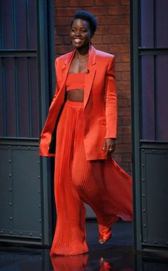 Lupita Nyong'o on Late Night with Seth Meyers : Lupita effortlessly nailed this red Balmain outfit with matching Oscar de la Renta shoes. Her hair and makeup was on point. Love this look to bits! Mode Outfits, Fashion Outfits, Womens Fashion, Fashion Tips, Fashion Trends, Ladies Fashion, Office Outfits, Fashion Beauty, Looks Chic