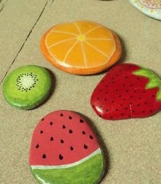 Rocks painted to look like pieces of fruit! So cute -- and easy too!