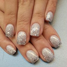 I like this, silver polish with a larger glitter overlay 3/4 down the nail.  I'd do an almond shape.