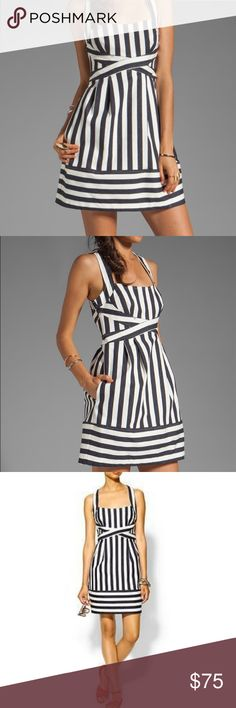 NANETTE LEPORE | Nautical Dress Dark stripes pattern a tailored sundress giving it a crisp, nautical edge. The fitted bodice gives way to a pleated waist and structured skirt, and a hidden zip closes the back making it the perfect on-trend choice.  * Style: Waterfront Dress * On-seam hip pockets * Stretch denim * Cotton/elastane blend  * Two tiny spots near waist only seen up close but otherwise excellent condition * Plz ask for measurements as brand runs small  Reasonable offers considered…