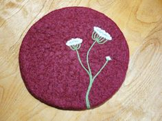 Trendy maroon color wool felted hot pad/trivet with a special needle felted Queen Annes Lace design. One of my all time favorite flowers has been the