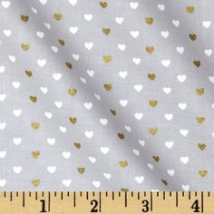 From Michael Miller, this cotton print is perfect for quilting, apparel and home decor accents. Colors include grey and white with gold metallic hearts.