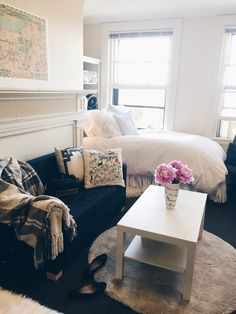 Tip #3: Designate separate areas to create intimacy. We love how inviting this dorm room became simply by tucking in a tiny little loveseat and a coffee table over a shag rug!