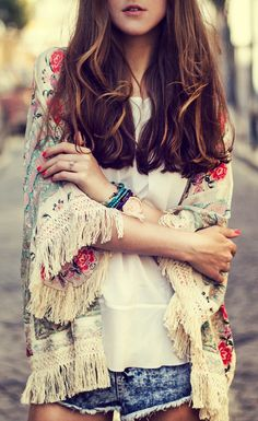 Katerina K. is wearing a floral kimono from Sheinside and denim cutoffs