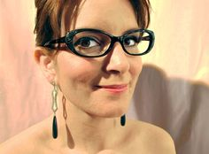 """Va-Va-Valentino » Tina Fey was """"Saturday Night Live's"""" first female head writer. The vision of a true leading lady, she dresses up her signature black frame with a dash of embossed florals in Valentino optical style V2609 from @Marchon Eyewear."""