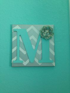 Painted Canvas with wooden letter.