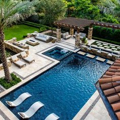 THIS is the inspiration for our future pool upgrade. I especially love the two-tone decking and the straight lines with offset interest will go great with our modern ranch design.