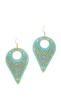 $255  Miguel Ases Drop EarringsFrench-hook earrings in a reverse teardrop shape are filled with polished metallic beads and irregular turquoise stones.  14k gold fill. Made in the USA.  MEASUREMENTS Length: 3in / 7.5cm