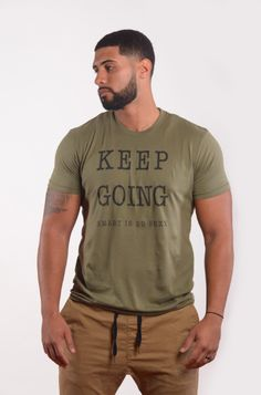 Men's KEEP GOING Positive Shirt Fitted Short-Sleeve Crew Neck - Military Green Tee Proceeds from each shirt sold goes to buying backpacks and school supplies to children in Jamaica (see our about us p
