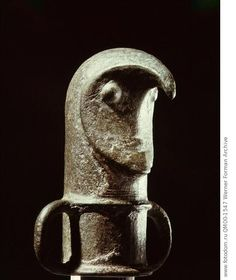 Bird-like mask used as a mount for the top of a staff. In Viking art the bird motif is often associated with Odin. Country of Origin: Sweden. Culture: Pre-Viking. Date/Period: Late Bronze Age. Place of Origin: Glasbacka. Material Size: bronze, h = c.7cms. Credit Line: Werner Forman Archive/ Statens Historiska Museum, Stockholm . Location: 18.