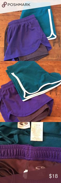 Run or jump Two pairs of workout shorts size large and both have drawstrings. The purple and black pair is by champion and has an inner liner of black shorts. The teal green is mostly cotton with spandex by Athletic works Champion Shorts