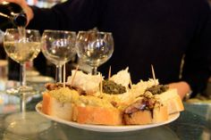 June 2013 - A little pre-dinner teaser in #Venice this evening, at our favorite #cicchetti bar: herring, spicy pistacchio, brie & arugula pesto, baccala, shrimp, tuna & cocoa, and - of course - a couple of glasses of wine. Happy mid-week, everyone!