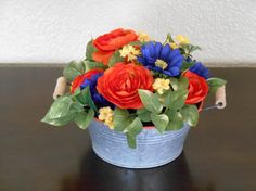 Check out this item in my Etsy shop https://www.etsy.com/listing/399408627/artificial-orange-ranunculus-blue