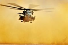 Marine Corps CH-53 Super Stallion Helicopter kicks up some dust (U.S. Air Force photo by Staff Sgt. Kenny Holston/Released)