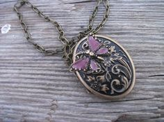 Hmmm what photos would go best in this locket. Maybe portraits of . . . BUTTERFLIES?!