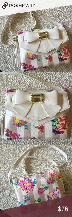 """NEW! BETSEY JOHNSON FLORAL CROSS BODY BAG BRAND NEW! AUTHENTIC BETSEY JOHNSON FLORAL CROSS BODY BAG-Approximate Measurements are 7 1/2 X 10"""", with an adjustable removable strap, that drops approximately 22""""-25""""...,NEVER USED!! EXCELLENT NEW CONDITION!! Betsey Johnson Bags Crossbody Bags"""