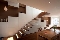 No railing, just steps attached to the wall mimic floating shelves.