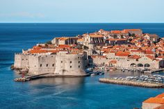 Dubrovnik, Croatia - Perhaps the most famous location on this list, the city of Dubrovnik has an Old Town surrounded by a fortified wall, which protected against attacks by both land and sea. Walking its perimeter is a popular tourist activity. Be sure to visit the famous bars called buzas that are perched outside the wall, overlooking the ocean.
