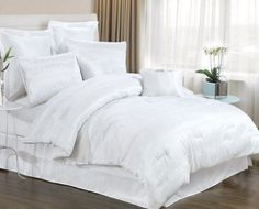 8 PIECE WHITE BEDDING SET INCLUDES COMFORTER. KING & QUEEN SIZE AVAILABLE.