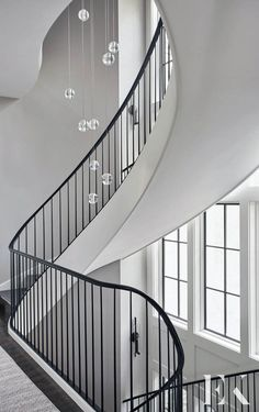 Contemporary Chandelier and Spiral Staircase Spiral Staircase Dimensions, Spiral Staircase Kits, Staircase Design, Staircase Ideas, Modern Staircase, Rustic Country Kitchens, Country Dining Rooms, Sophisticated Living Rooms, White Beadboard