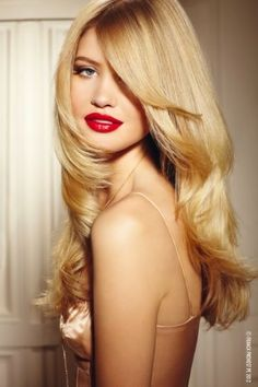 Long layers!  I think he would love this look.  I really the red lipstick and soft romantic eye