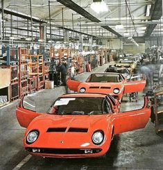 Miuras coming down the production line at Bertone SpA's Grugliasco plant. Sports Cars Lamborghini, Lamborghini Miura, Lamborghini Factory, Chevrolet Monza, Classic Wooden Boats, Maserati Ghibli, Pretty Cars, Car In The World, Automotive Design
