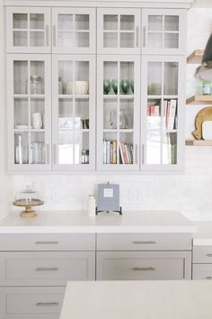 Cabinet Color – Sherwin Williams Mindful Gray, Countertop – Caesarstone Organic White / Floors