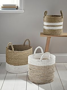 Woven from natural seagrass with three complementary striped patterns, our useful storage baskets will help to keep your living space chic and tidy. Each set contains three sizes each with two petite handles, perfect for storing anything from magazines and toys to towels and blankets.