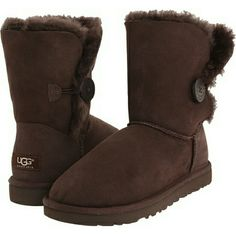 UGG Bailey Button Chocolate Color Twin faced Sheepskin uppers with suede heel guards for added structure. Boot cuff can be worn up or folded over depending on style preference. Fully lined in luxurious UGG pure wool. Flexible and durable molded EVA outer sole assures an easy stride. UGG Shoes