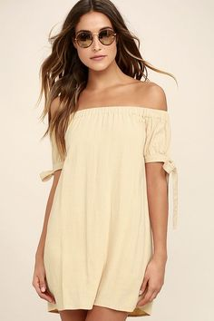 The perfect dinner date starts with the Al Fresco Evenings Beige Off-the-Shoulder Dress, and ends with drinks on the patio! Breezy woven rayon falls from an elastic, off-the-shoulder neckline into a shift bodice, framed by short sleeves with cute side ties.